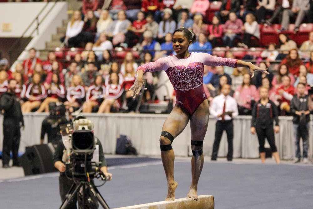 Alabama gymnastics overcomes early set backs to defeat Georgia in first home meet