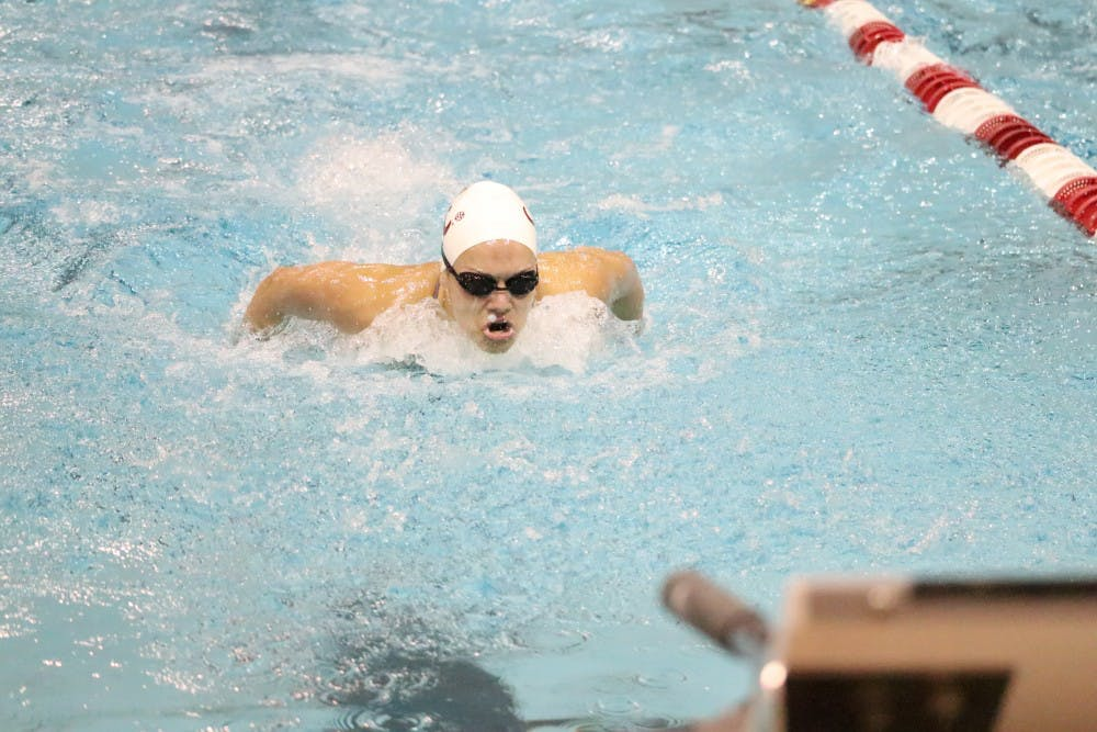 Christopher Reid wins 200 backstroke at SEC Championships