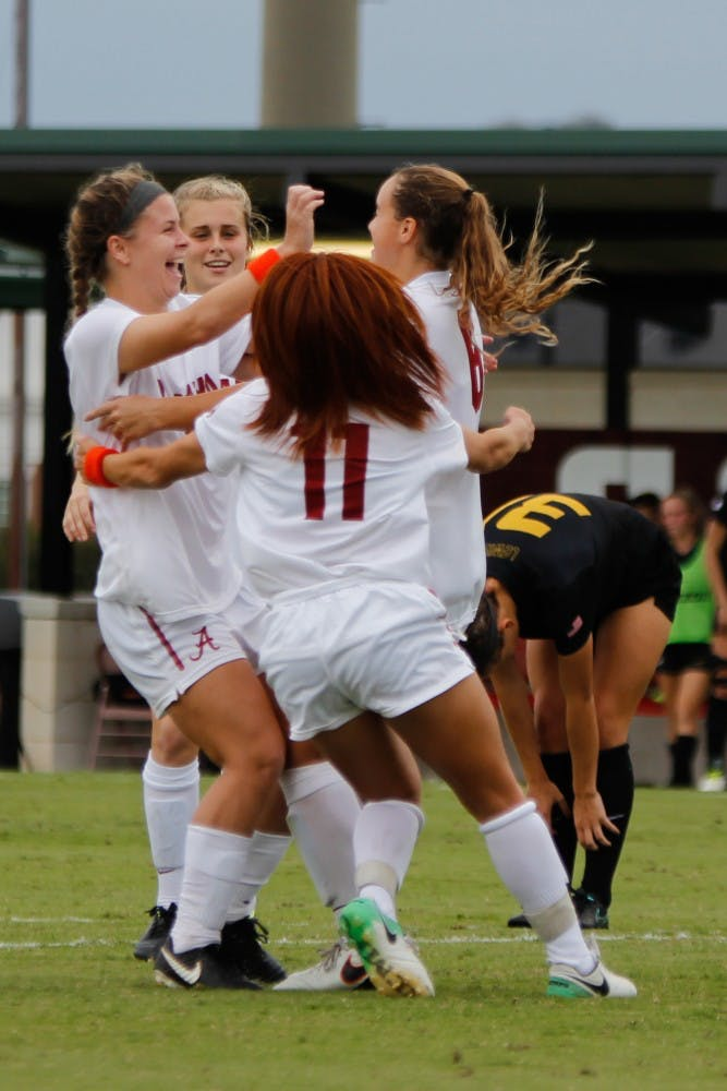 Alabama holds off Missouri in overtime