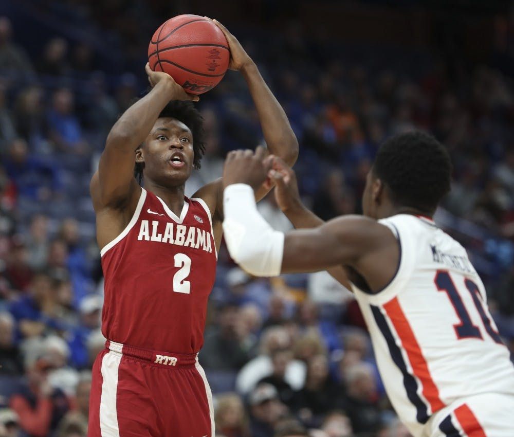 Sexton drives Crimson Tide past No. 16 Auburn