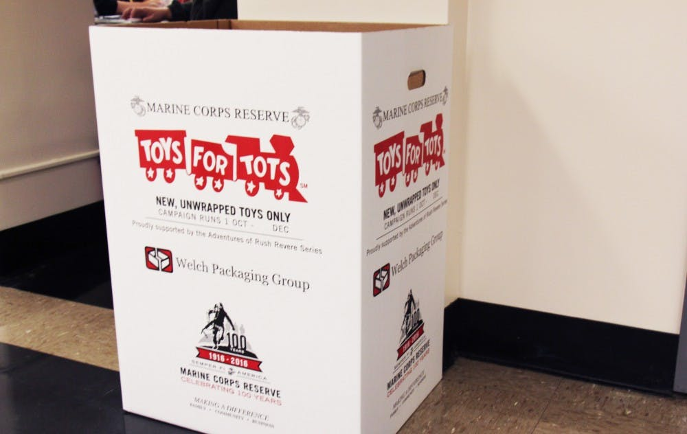 Libraries, fraternity kickoff annual Toys for Tots drive