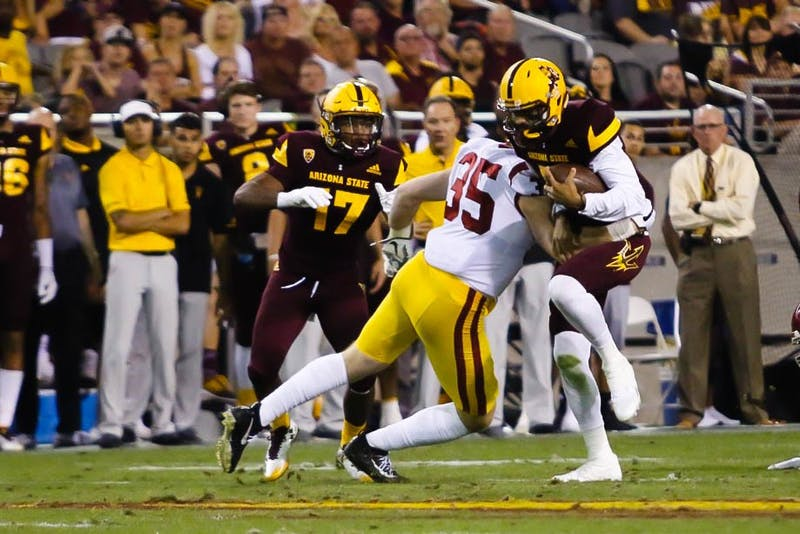 Manny Wilkins Takes a Hit from Cameron Smith