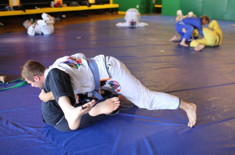 Two members at Auburn Jiu Jitsu practice technique.