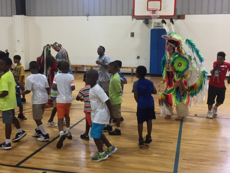 Children of the Boys and Girls Club dance with members of the Poarch Creek Indians on July 27, 2017 in Auburn, Ala.