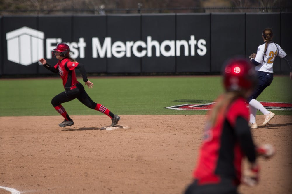 Taylor Castleberry rounds second after Stacy Payton hits a ball to the outfield in the fifth inning during the Cardinals' game against Kent State April 7 at the Softball Field at First Merchants Ballpark Complex. Eric Pritchett, DN