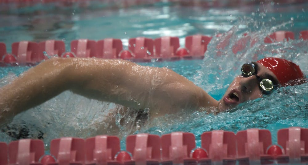 Senior Issac Walling swims the 1000 yard freestyle during the meet against Tiffin on Nov. 11 in the Lewellen Aquatic Center. Terence K. Lightning Jr., DN File