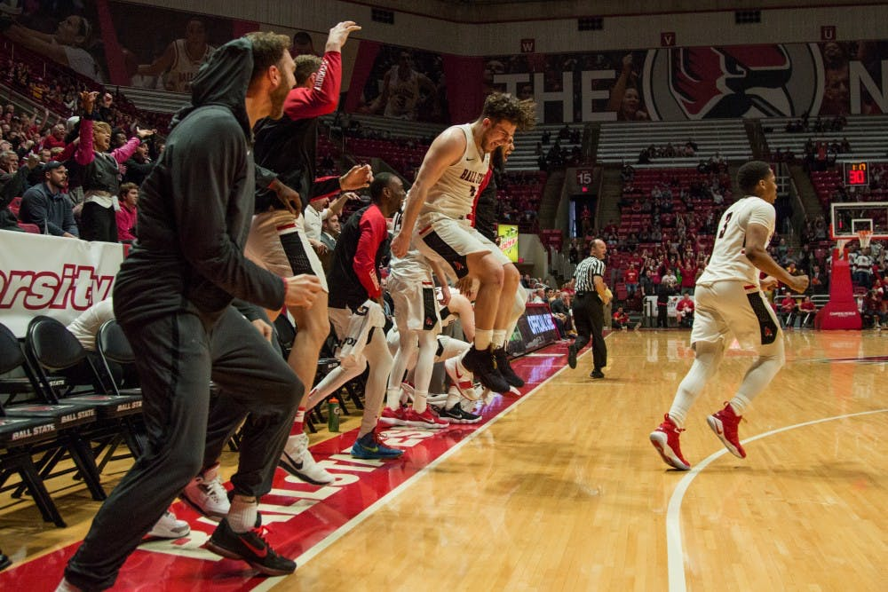 Ball State's bench, along with the rest of Worthen Arena, goes wild after Freshan Tyler Leddy scored his first points of the game against Toledo, OH in Worthen Arena on Feb. 17. Eric Pritchett, DN