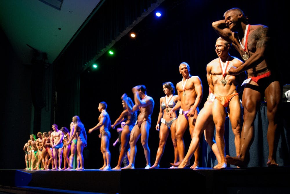 Contestants for the Mr. and Mrs. Ball State bodybuilding competition line up on stage April 19 in Emens Auditorium. Sara Barker, DN