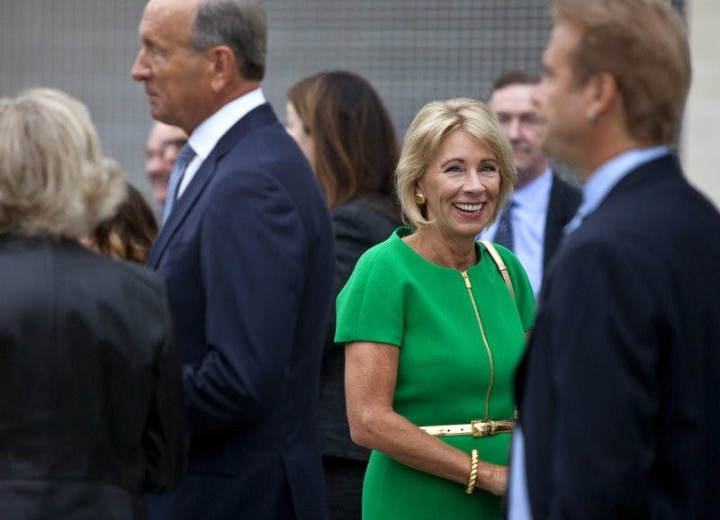U.S. Education Secretary Betsy DeVos arrives at the dedication ceremony of Michigan State University's new Grand Rapids Medical Research Center on Wednesday, Sept. 20, 2017, in Grand Rapids, Mich. Associated Press, Photo Provided
