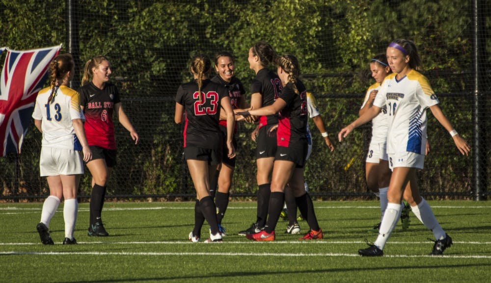 The Ball State soccer team celebrates a goal made during the game against Morehead State on Sept. 16, 2016 at the Briner Sports Complex. Ball State won 4-0. Grace Ramey, DN File