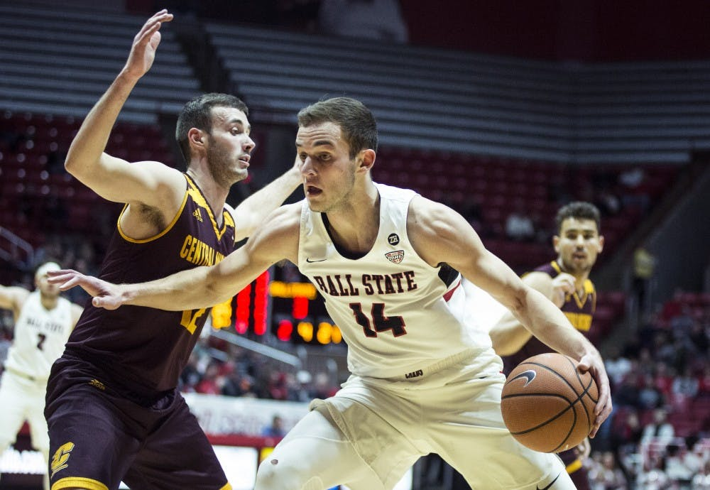 Sophomore forward Kyle Mallers pushes down the court against a Central Michigan guard, Jan. 16 at John E. Worthen Arena. Ball State defeated Central Michigan, 76-82. Grace Hollars, DN