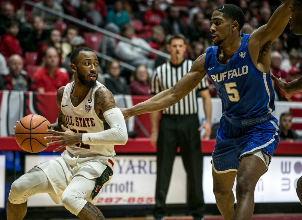 Senior gaurd Jeremie Tyler attempts to pass a Buffalo player during the game on Jan. 6 in John E. Worthen Arena. Kaiti Sullivan, DN File