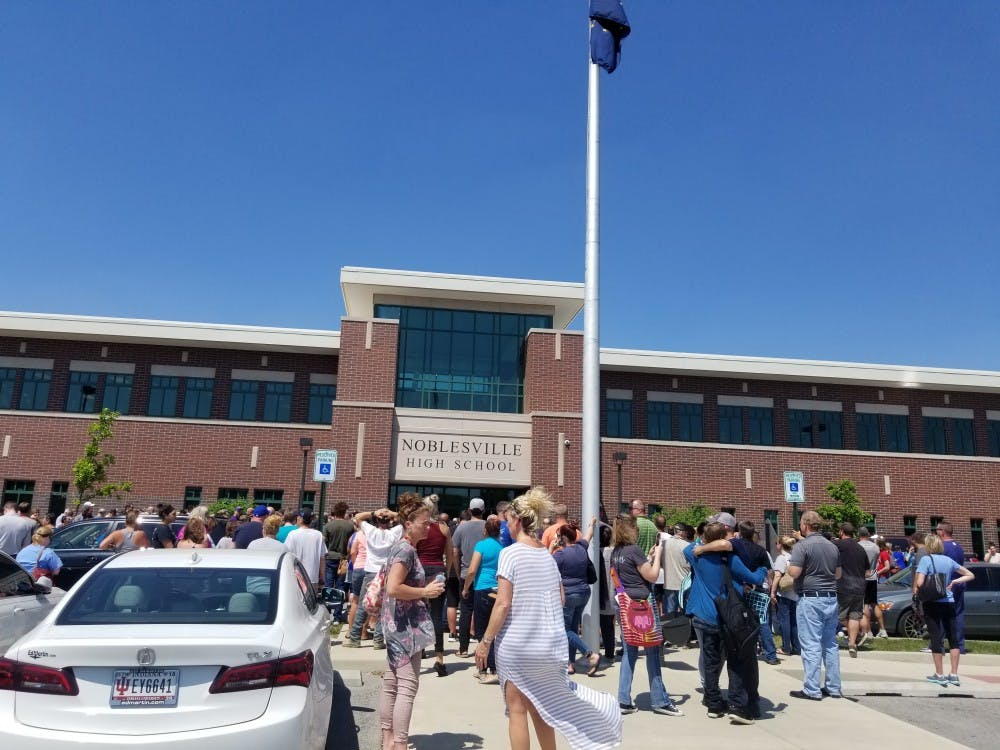 Family members gathered outside Noblesville High School as they waited for students to be released following the school shooting at Noblesville West Middle School Friday, May 25. Two were injured in the shooting. Stephanie Amador, DN Photo