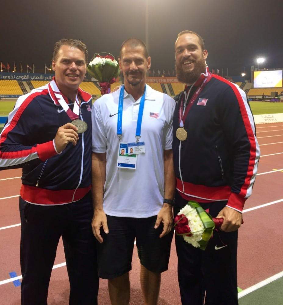 (From left to right) David Blair, Larry Judge and Jeremy Campbell pose for a picture following the 2015 IPC World Championships in Doha, Qatar. Judge coached the gold and silver medalists in the F44 discus throw. Larry Judge // Photo Provided