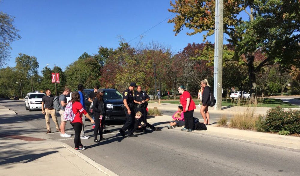 A pedestrian was struck by a car while crossing the street near the Applied Technology Building Oct. 20. The student was transported with minor, non-life threatening injuries. Brynn Mechem, DN Photo.
