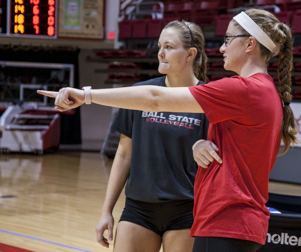 Sabrina Mangapora coaches Senior Jessica Lindsey during practice on Oct. 4 in John E. Worthen Arena. Mangapora is a student assistant coach after being medically disqualified before the 2017 season. Kaiti Sullivan, DN