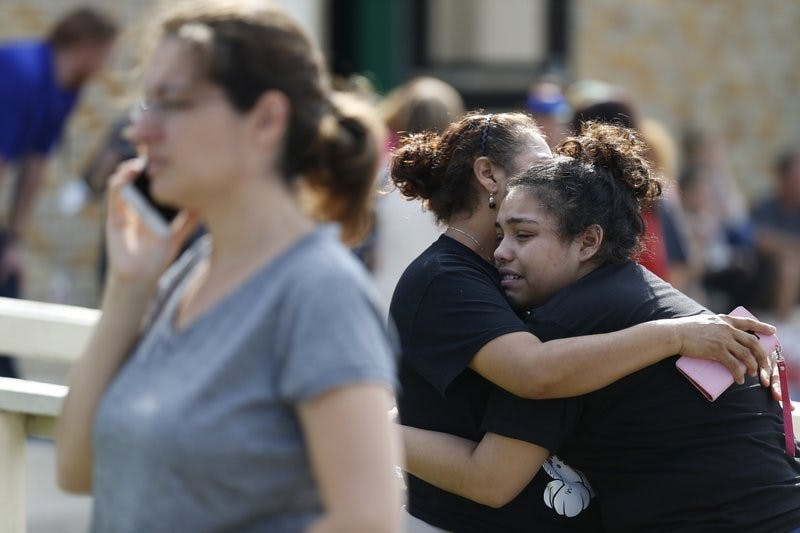 Santa Fe High School junior Guadalupe Sanchez, 16, cries in the arms of her mother, Elida Sanchez, after reuniting with her at a meeting point at a nearby Alamo Gym fitness center following a shooting at Santa Fe High School in Santa Fe, Texas, on Friday, May 18, 2018. AP Photo