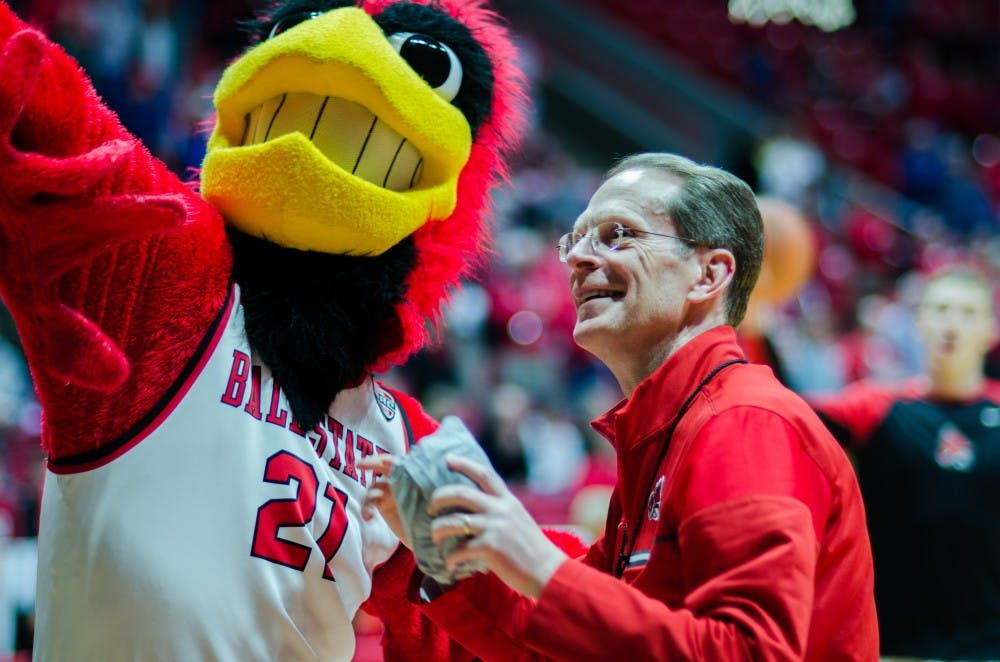 President Geoffrey Mearns and Charlie Cardinal throw a t-shirt to the fan section Feb. 9 in the John E. Worthen Arena. Ball State's men's basketball team defeated Kent State 87 to 68 for the first time since 2005. Stephanie Amador, DN