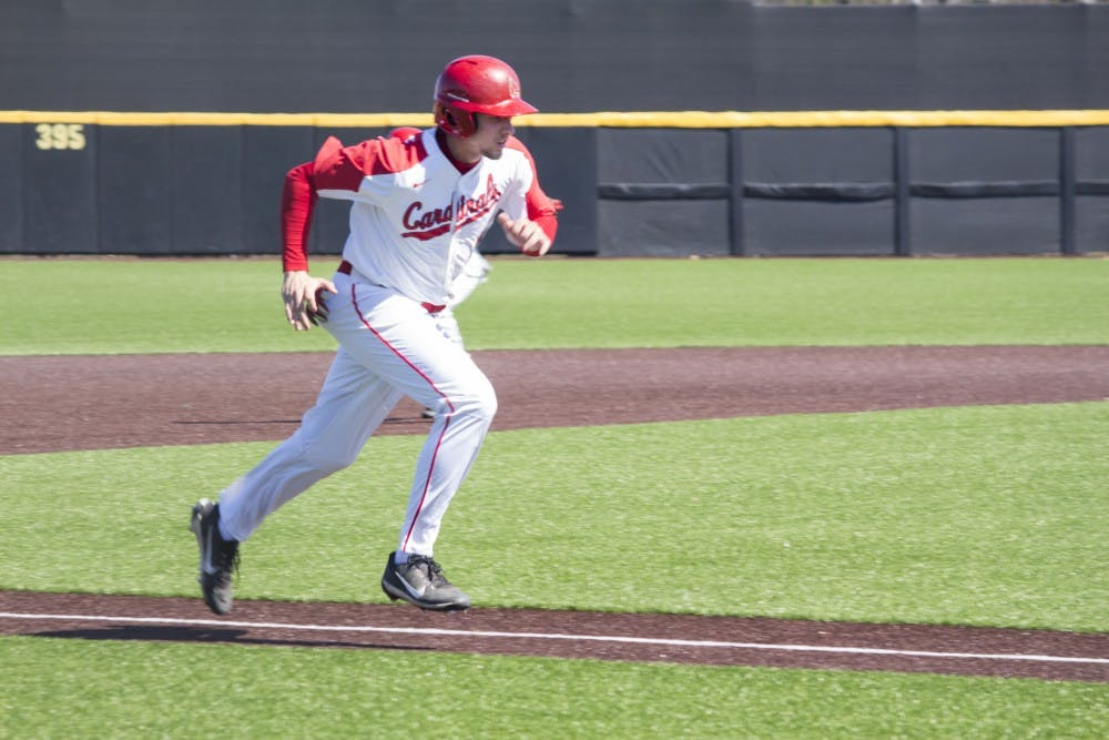 Ball State baseball player Rhett Wintner runs home during the game against the University of Dayton on March 18 at the Baseball Diamond at First Merchant's Ballpark Complex. Dayton got the third out during the play, so the run did not count. Briana Hale, DN