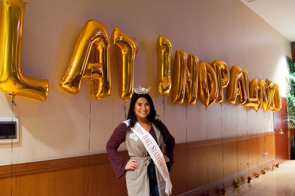 Miss Ball State, Victoria Ruble, poses by the Latinapalooza balloons on Jan. 19. Madeline Grosh, DN