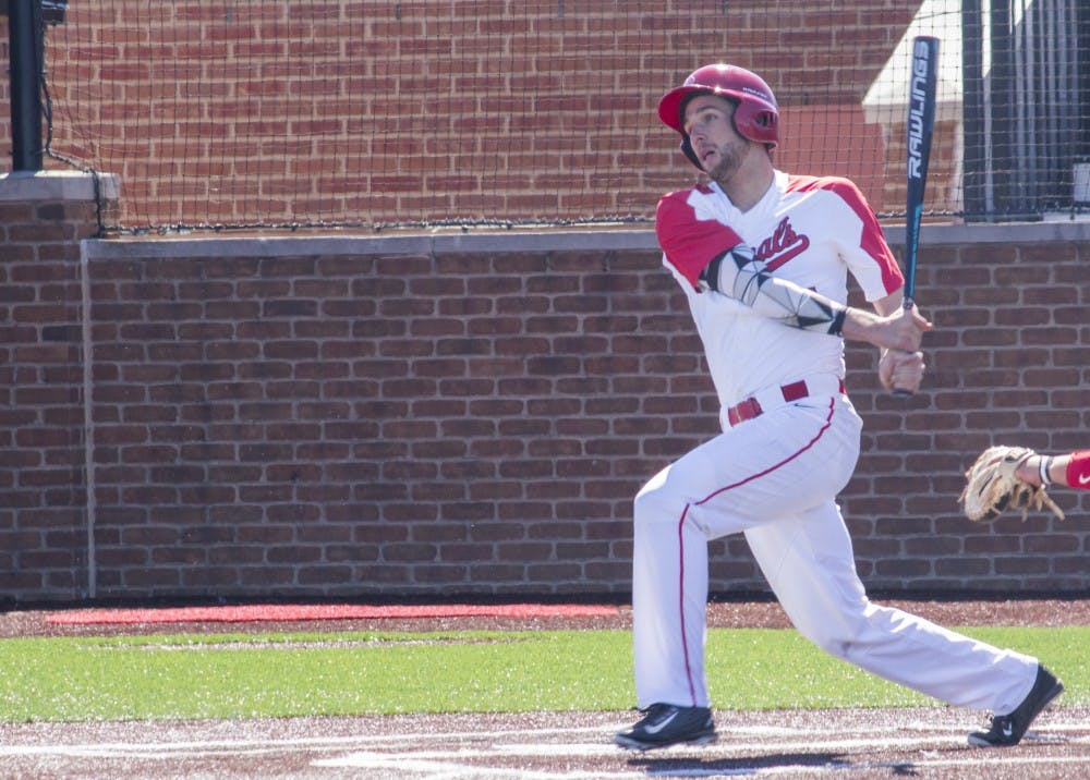 Ball State men's baseball player Jeff Riedel hits the ball during the game against the University of Dayton on March 18 at the Baseball Diamond at First Merchant's Ballpark Complex. Briana Hale, DN