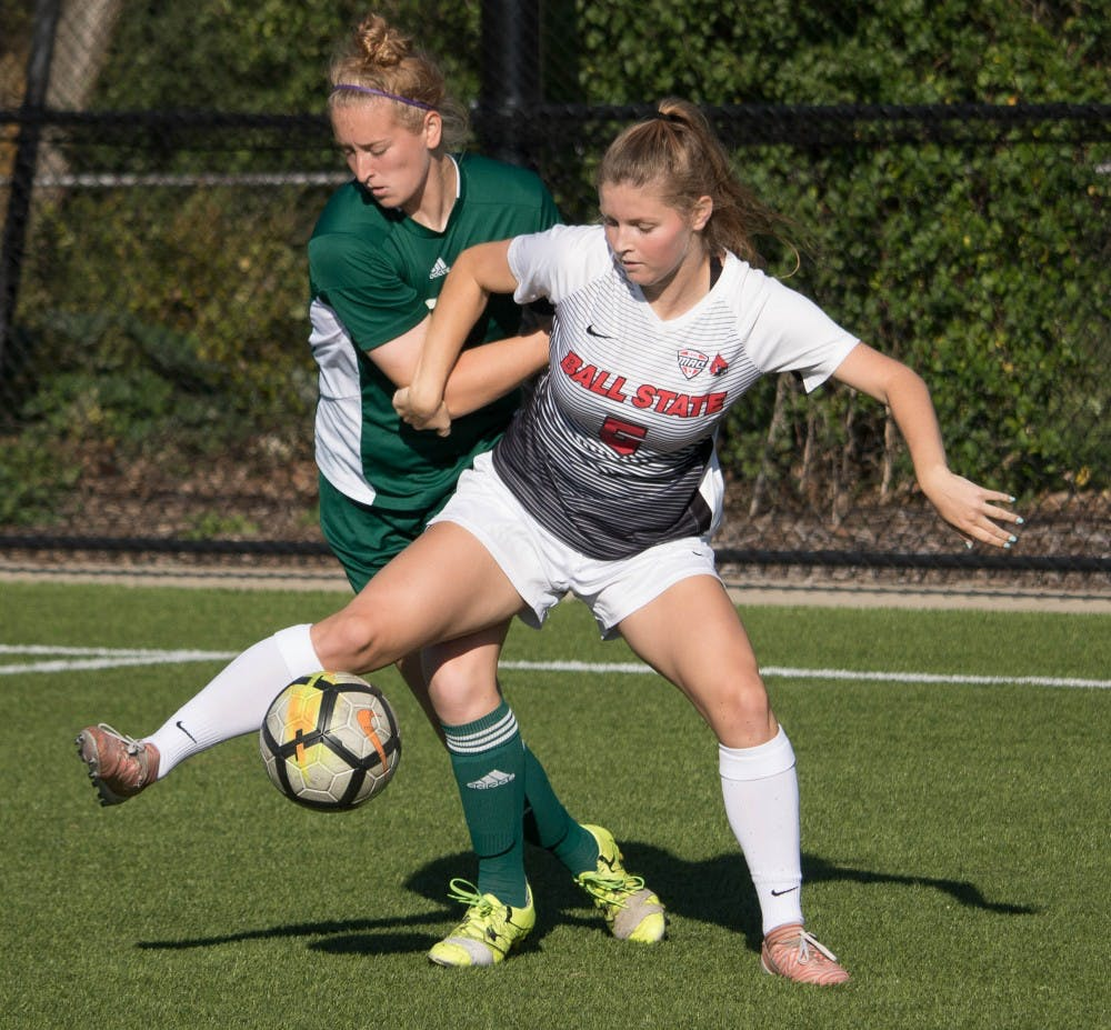 Freshman forward Greer Glover keeps possession of the ball against an Eastern Michigan player at Briner Sports Complex on Oct. 13. Rebecca Slezak, DN