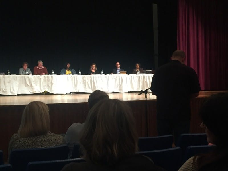 The school board decided to postpone voting on any budget reduction plans until community meetings take place where community members will be able to voice their thoughts. Max Lewis, DN File