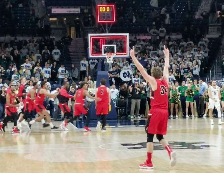 The Ball State men's basketball team runs onto the court after upsetting No. 9 Notre Dame 80-77 on Dec. 5 at Edmund P. Joyce Center. Junior guard Tayler Persons made the game-winning shot with 1.7 seconds left. Screenshot from video by Robby General, DN.