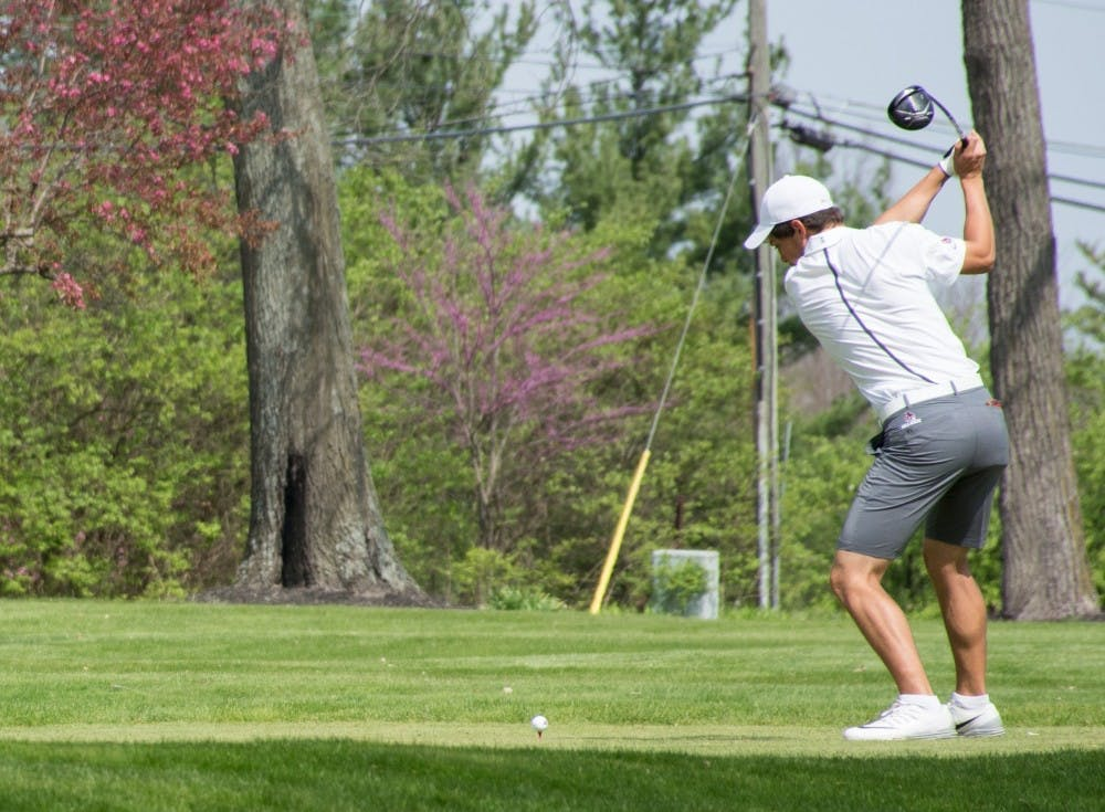 Junior Michael Makris swings at the ball on hole 11 during the Earl Yestingsmeier Memorial Invitational on April 14 at the Delaware Country Club. Makris lead the Cardinals 69 and 71 in his first two rounds. Kaiti Sullivan, DN File