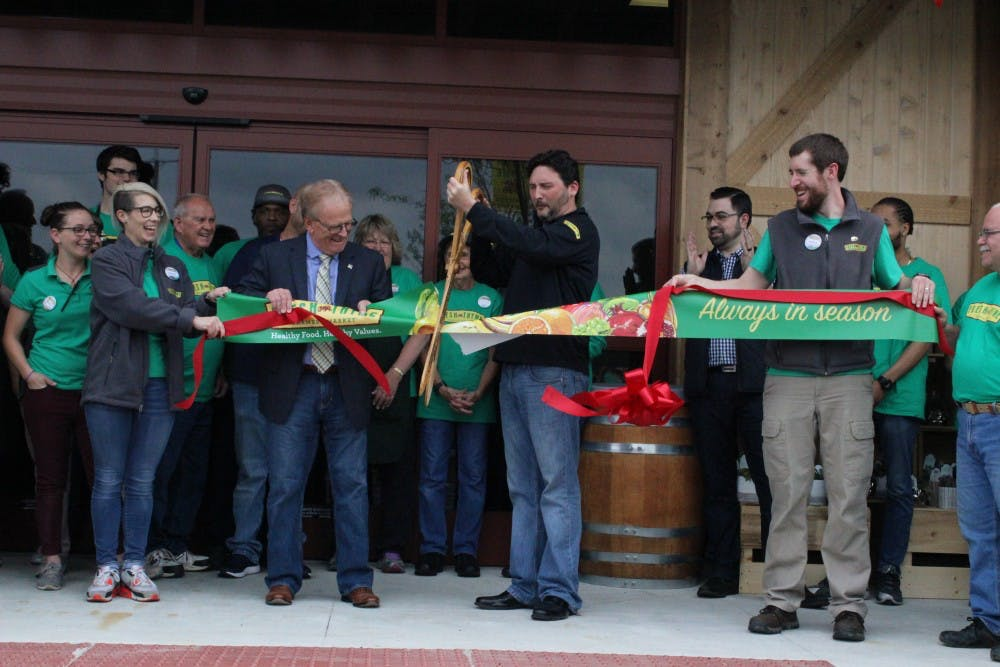 Mayor Tyler Dennis and Fresh Thyme employees cut the ribbon for their grand opening, Wednesday May 16 at the organic grocery store, Fresh Thyme. The store is located on West McGalliard road, next door to Chick-fil-A. Andrew Smith, DN