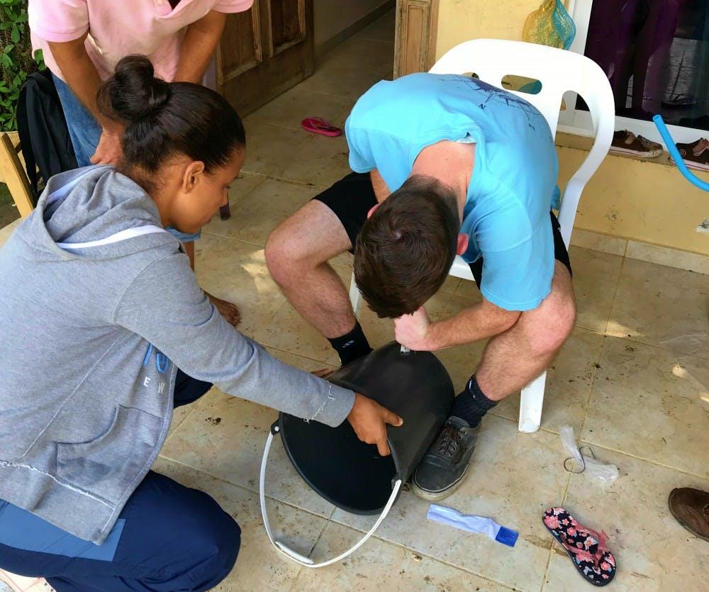 Josh Heideman installs the water filtration system in the Dominican Republic. Josh Heideman, Photo Provided