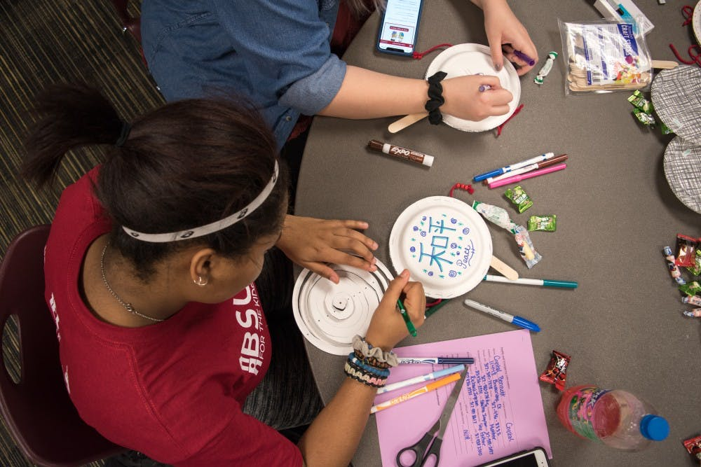 Freshman Crystal Bennett, medical technology major, decorates a plate drum to celebrate Lunar New Year on Feb. 19 at the L.A. Pittenger Student Center. Student decorate plate drum sticks for Lunar New Year 2018 to celebrate the year of the Dog at American Asian Student Association event. Stephanie Amador, DN