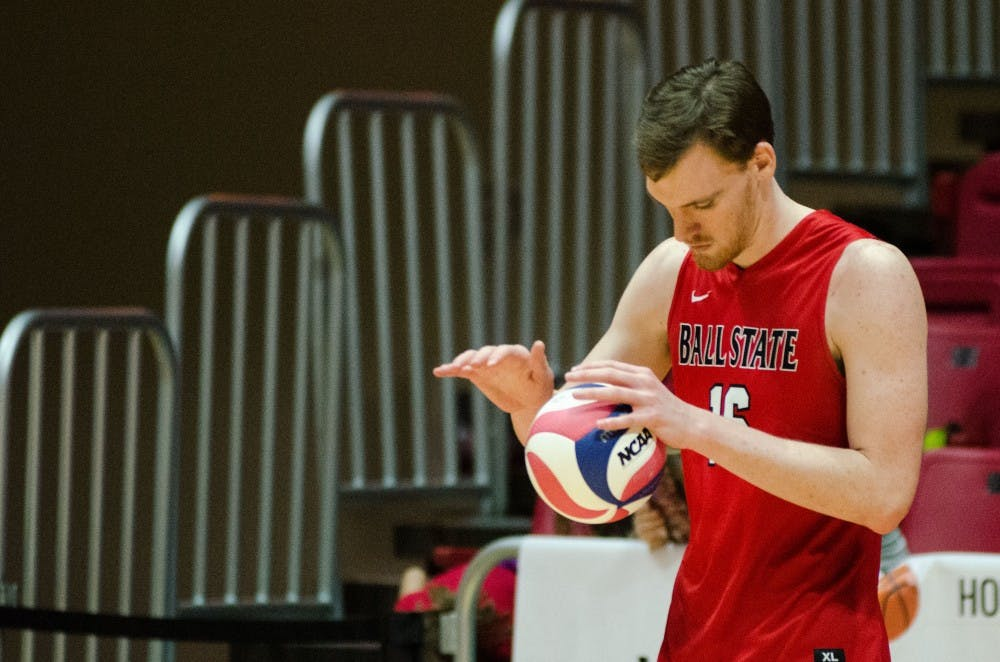 Senior middle attacker Matt Walsh prepares to serve the ball to Lewis University during a match on Feb. 16 in John E. Worthen Arena. Madeline Grosh, DN