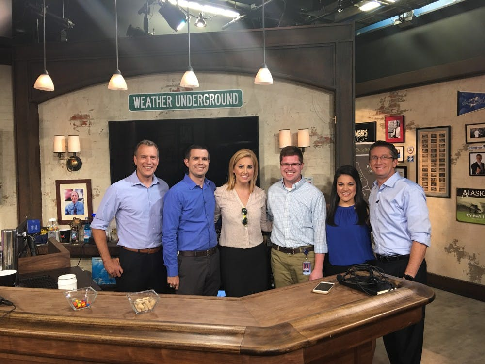 Nathan DeYoung (fourth from left) with the Weather Underground on-air team. Photo Provided
