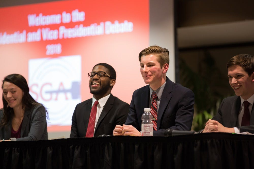 Kyleigh Snavely, secretary, Jalen Jones, treasurer, Matt Hinkleman, vice president, and Isacca Mitchell, president of Amplify during the 2018 All Slate debate hosted by the Student Government Association at L.A. Pittenger Student Center on Feb 18. Eric Pritchett, DN