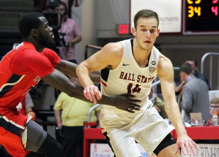 Sophomore forward Kyle Mallers gets fouled by Stony Brook's Junior Saintel as he brings the ball down the court during Ball State's game against the Seawolves on Nov. 17 in John E. Worthen Arena. Mallers got 26 minutes of playing time. Paige Grider, DN