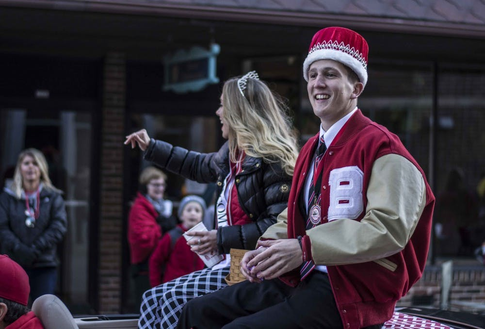 Homecoming King and Queen Mitch Prather and Samantha Johnson wave during the 2016 Homecoming Parade. Samantha Brammer, DN File