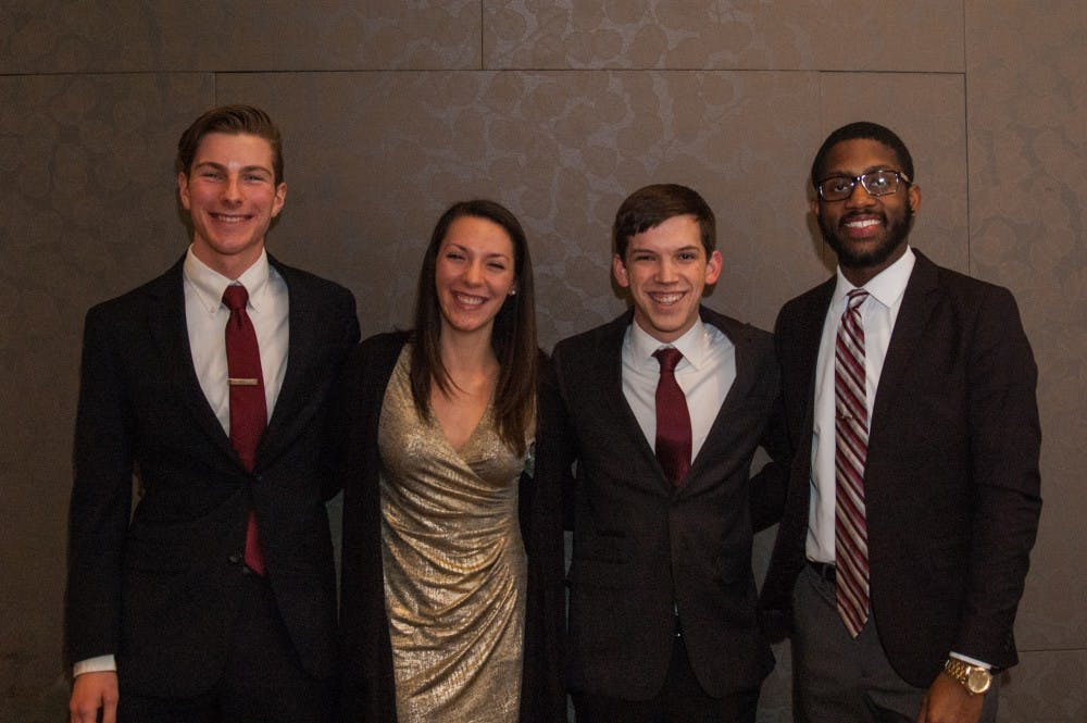 Amplify's Matt Hinkleman, vice president, Kyleigh Snavely, Secretary, Isaac Mitchell, president, Jalen Jones, treasurer pose for a photo after being slated for the upcoming SGA elections on Feb. 12. Madeline Grosh, DN