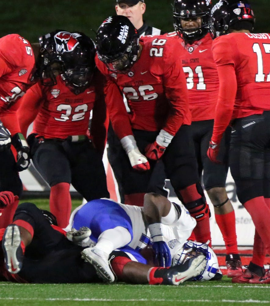 The Ball State defense loomes over Buffalo's Theo Anderson after stopping him just short of a touchdown during the Cardinals' game against the Bulls on Nov. 16 at Scheumann Stadium. Ball State lost 24 to 40. Paige Grider, DN