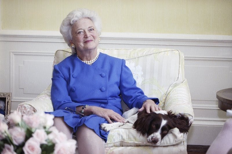 In this 1990 file photo, first lady Barbara Bush poses with her dog Millie in Washington. A family spokesman said Tuesday, April 17, 2018, that former first lady Barbara Bush has died at the age of 92. AP Photo