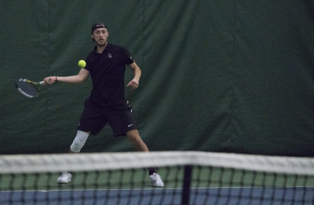 Junior Ball State men's tennis player Conner Andersen goes to return the ball during a singles set against Eastern Illinois University on Jan. 20 at the Northwest YMCA of Muncie. During his sophomore season, Andersen had the most registered singles wins. Briana Hale, DN