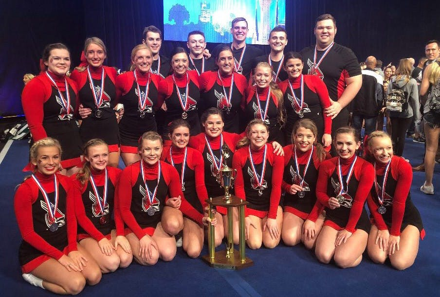 Ball State cheer team poses with their second place trophy at the Universal Cheerleaders Association in Orlando, Florida Jan. 12-14. They second place finish was a program best. Brenda Jamerson, Photo Provided
