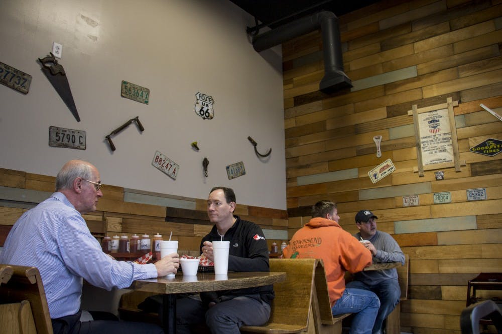 Guests eat at MT's Smokin' BBQ Feb. 15. Travis and Mandy Thorrington started this business as a food truck and now customers can enjoy their meals inside the new restaurant. Eric Pritchett, DN