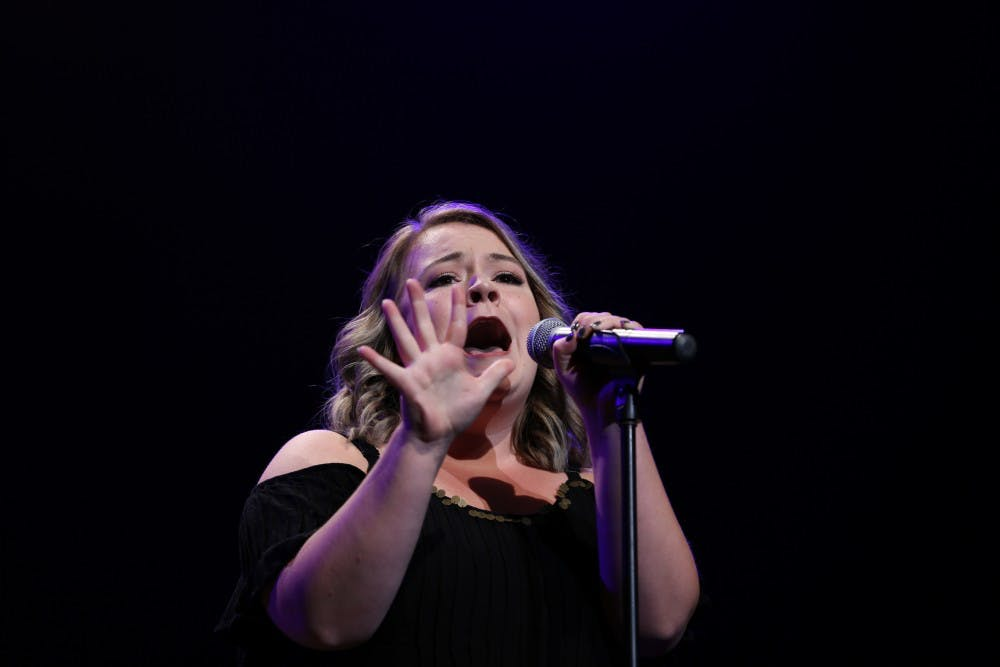 """Paige Matteson sings """"Gravity"""" by Sara Bareilles during the 33rd annual Talent Search in John R. Emens Auditorium on Tuesday, Oct. 17, 2017. Matteson won the female vocal and overall categories and received $1,000 in scholarship money. Mary Freda, DN"""