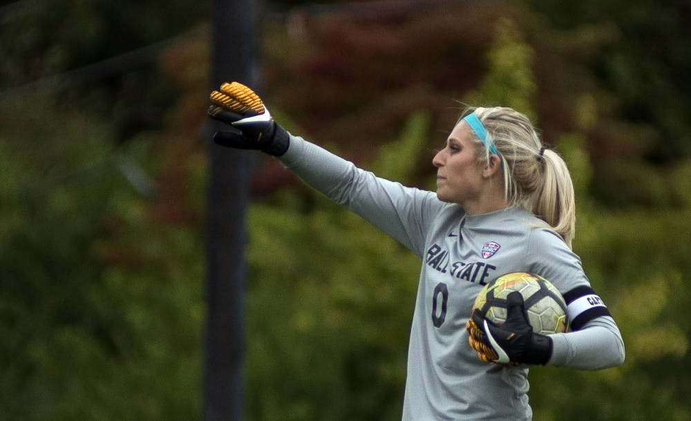 Senior goalkeeper Alyssa Heintschel yells to her teammates before putting the ball back into play against Northern Illinois Oct. 8 at the Briner Sports Complex. Breanna Daugherty, DN File