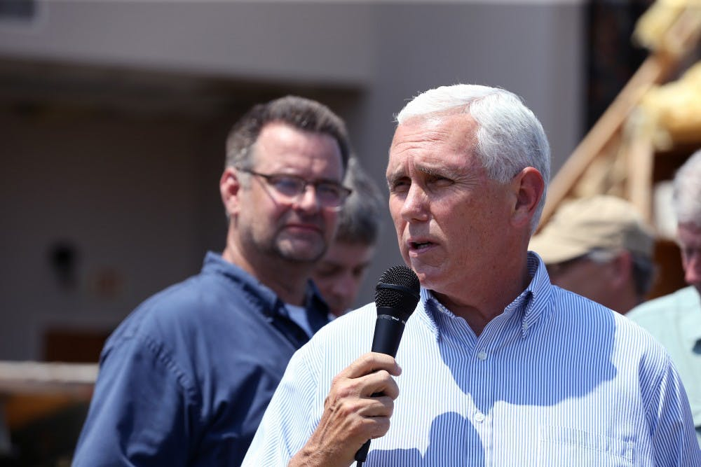 Scott Jones, senior pastor of First Baptist Rockport, listens as Vice President Mike Pence speaks in Rockport, Texas at the First Baptist Rockport on Thursday, Aug. 31, 2017. Several secretaries of state and the vice president visited Rockport to reaffirm the federal government's promise of help for victims of Hurricane Harvey. TNS, Photo Provided