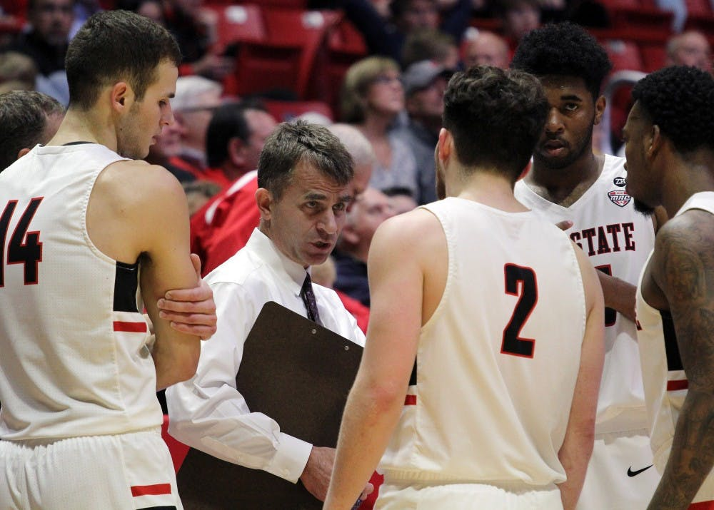 Head Coach James Whitford talks to the Cardinals during a timeout with 23.1 seconds remaining in the second half during Ball State's game against Stony Brook on Nov. 17 in John E. Worthen Arena. The Cardinals won 87 to 76. Paige Grider, DN