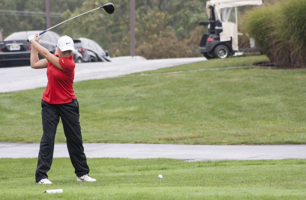 Freshman Holly Anderson tees off on Sept. 19 during the Cardinal Classic. The Cardinals competed against over 20 teams. Kaiti Sullivan, DN File