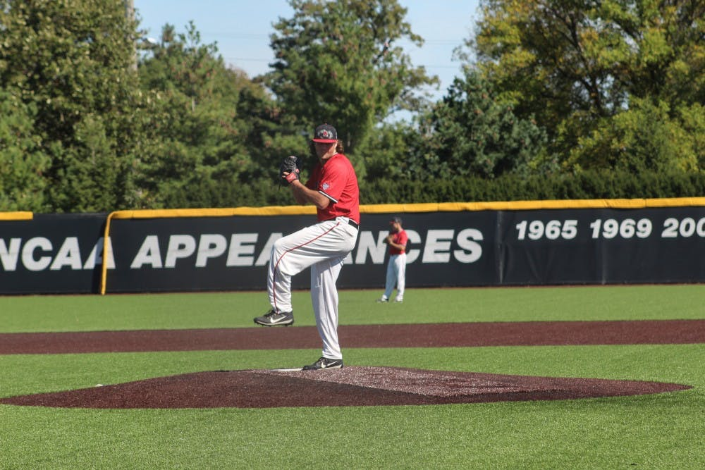 Redshirt junior pitcher Evan Marquardt pitches the ball during the Red and White scrimmage game on Oct. 2 at Ball Diamond at First Merchants Ball Park. The teams season starts in the spring. Kara Biernat, DN