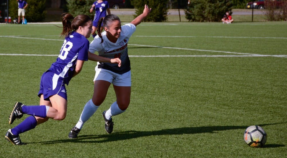 Junior midfielder Paula Guerrero fights for ball on Sept. 15 at the gae against Western Illinois in Briner Sports Complex. The Cardinals won with one point during the first half and two points during the second. Harrison Raft, DN File